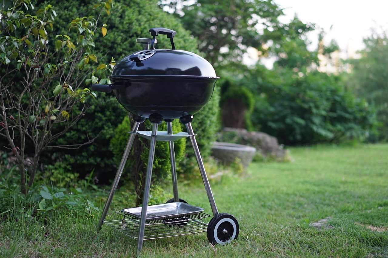 portable charcoal grill at a garden