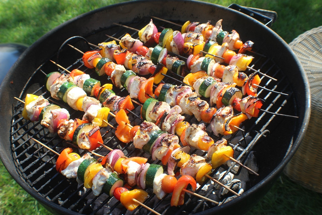 beef skewers on a charcoal grill